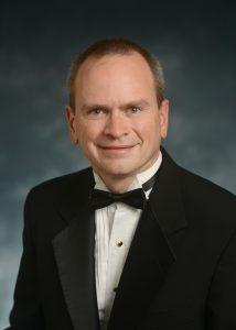 Mr. Travis Almany